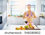 young athletic woman holding... | Shutterstock . vector #548280802