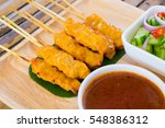 pork satay grilled pork served... | Shutterstock . vector #548386312