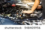 hand of auto mechanic with a...