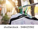 clothing on wire hanger at home ... | Shutterstock . vector #548425582
