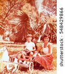 Small photo of USSR, ABKHAZIA, SUKHUMI - CIRCA 1983: Vintage photo of brother and sister