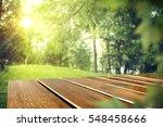 wooden desk in garden and free... | Shutterstock . vector #548458666