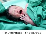 baby crying after birth in... | Shutterstock . vector #548487988