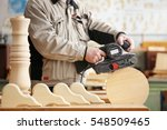 man doing woodwork in carpentry   Shutterstock . vector #548509465