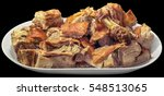 plateful of spit roasted pork... | Shutterstock . vector #548513065