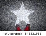 sneakers on asphalt road with...