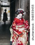maiko geisha walking on a... | Shutterstock . vector #548555455