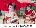 maiko geisha walking on a... | Shutterstock . vector #548562352