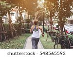 young woman running in the park ... | Shutterstock . vector #548565592
