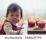Baby Girl With Cup Cake At Home ...