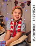 the boy in the striped scarf at ... | Shutterstock . vector #548645266