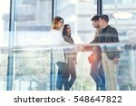 four colleagues meet in the... | Shutterstock . vector #548647822