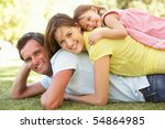 young family relaxing in park | Shutterstock . vector #54864985