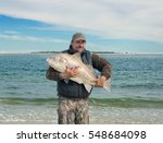 Happy Fisherman Holding A Huge...