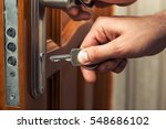 male hand puts the key in the... | Shutterstock . vector #548686102