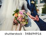 bride sits with a groom holding ... | Shutterstock . vector #548694916