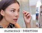 asian woman plucking eyebrows...   Shutterstock . vector #548695366