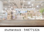 wood table top on blur with... | Shutterstock . vector #548771326