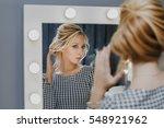 woman in a beauty salon looks... | Shutterstock . vector #548921962