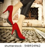 slim sexy woman legs and heels  | Shutterstock . vector #548924962