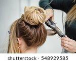 close up of stylist's hand...   Shutterstock . vector #548929585
