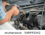 mechanic draining engine oil... | Shutterstock . vector #548993542