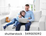 daughter helping father working ... | Shutterstock . vector #549005092