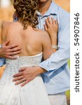 A vertical photo of a caucasian couple holding each other on their wedding day - stock photo