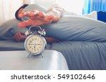 hand turns off the alarm clock... | Shutterstock . vector #549102646