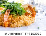 tasty risotto with shrimp ...   Shutterstock . vector #549163012