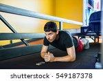 fitness man doing exercise... | Shutterstock . vector #549187378