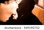 young handsome guy smoking... | Shutterstock . vector #549190732