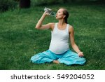 pregnant yoga woman drinking... | Shutterstock . vector #549204052