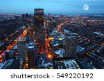 a rising moon over the city of... | Shutterstock . vector #549220192
