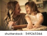 mother and daughter baking... | Shutterstock . vector #549265366