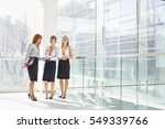 happy businesswomen standing... | Shutterstock . vector #549339766