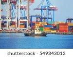 tugboat and crane in harbor... | Shutterstock . vector #549343012