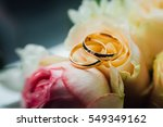 Two Gold Wedding Rings Lie On...