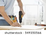midsection of man drilling nail ... | Shutterstock . vector #549350566