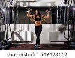 woman flexing muscles on cable... | Shutterstock . vector #549423112