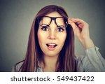 surprised girl taking off her... | Shutterstock . vector #549437422