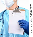 male doctor standing with... | Shutterstock . vector #549442975