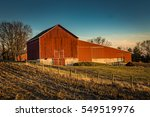 A Red Barn Late In The Day In...