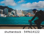a man cycling on new zealand... | Shutterstock . vector #549614122