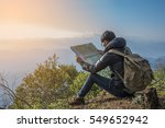 young man traveler with map... | Shutterstock . vector #549652942