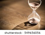 Small photo of Hourglass as time passing concept for business deadline, urgency and running out of time.