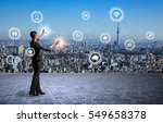 Stock photo modern cityscape and business person internet of things information communication technology 549658378