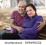 mature man with a woman sitting ... | Shutterstock . vector #549690226