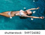 beautiful female in swimming... | Shutterstock . vector #549726082