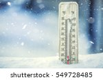 thermometer on snow shows low... | Shutterstock . vector #549728485